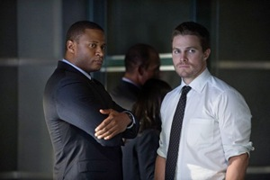"""Arrow -- """"City of Heroes"""" -- Image AR201a_0288b -- Pictured (L-R): David Ramsey as John Diggle and Stephen Amell as Oliver Queen -- Photo: Cate Cameron/The CW -- © 2013 The CW Network. All Rights Reserved"""